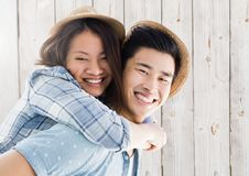 Portrait of man giving piggy back to woman Royalty Free Stock Photography