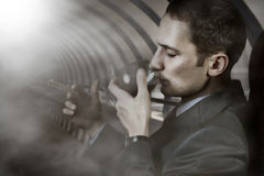 Portrait of man with glass and cigar Stock Photos