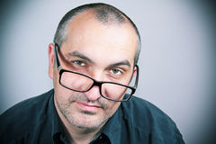 Portrait of a man with glasses. And a dark gray shirt Stock Photo