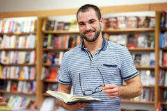 Portrait of a man with glasses in a bookstore Royalty Free Stock Images
