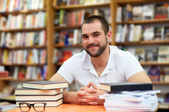 Portrait of a man with glasses in a bookstore Stock Images