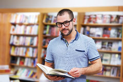 Portrait of a man with glasses in a bookstore Stock Photos