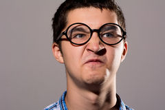Portrait of a Man in glasses with a silly expression on his face Royalty Free Stock Photography