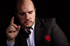 Portrait of man, godfather-like character. Studio shpt, black background Stock Photos