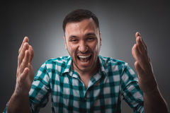 Portrait of man on gray background. Man showing different emotions. Stock Photos