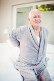 Portrait of man grimacing from back pain Stock Image