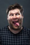Portrait of man grimacing Stock Image