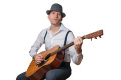 Man with hat plays acoustic guitar royalty free stock photos