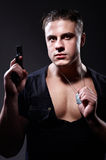 Portrait of man with a gun Stock Photography