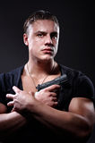 Portrait of man with a gun stock images