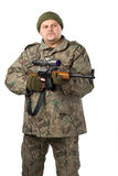 Portrait of a man with a gun on white. Stock Images