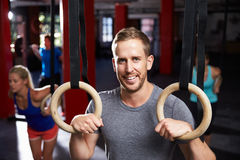 Portrait Of Man In Gym Exercising With Gymnastic Rings Stock Image