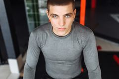 Portrait of a man in the gym, training, break from sports stock images