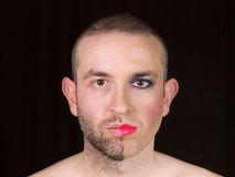 Portrait of a man with half face makeup as a woman Stock Images