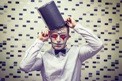 Portrait of Man on Halloween. The face of dead man in black hat. Halloween concept. Scary mask for Halloween. stock photos