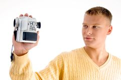 Portrait of man with handy cam. Against white background Stock Photography