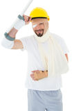 Portrait of a man in hard hat with broken hand and crutch Stock Photography
