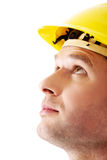 Portrait of a man with hardhat looking up Royalty Free Stock Images