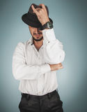 Portrait of man in hat and whirt in studio Royalty Free Stock Photo