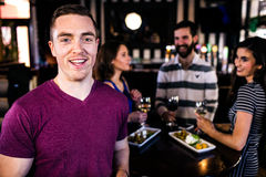 Portrait of man having a drink with friends Stock Photos