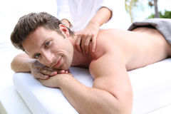 Portrait of man having a massage Stock Image