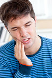 Portrait of a man having a raging toothache Royalty Free Stock Photo