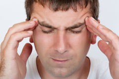 Portrait of a man with a headache Stock Photography
