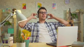 Portrait of a man in headphones enjoying music stock footage