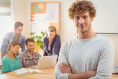 Portrait of a man with his colleague behind him Stock Photography