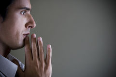 Portrait of a man with his hands in a praying position Royalty Free Stock Photos