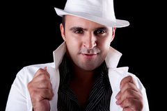 Portrait of a man with his white hat and coat Stock Images