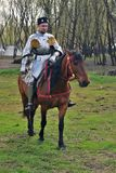 Portrait of a man in historical costume, he rides a brown horse Stock Photo