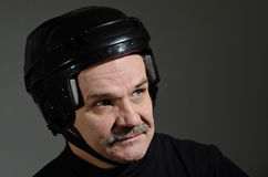 Portrait of a man in hockey helmet Stock Photo