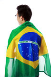 Portrait of a man holding Brazilian flag Royalty Free Stock Image