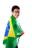 Portrait of a man holding Brazilian flag Royalty Free Stock Photography