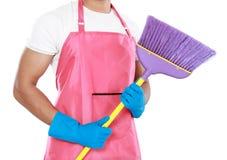 Portrait of man holding broom Royalty Free Stock Photo