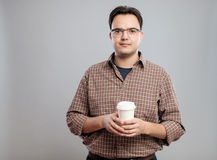 Portrait of man holding a cup of coffee Royalty Free Stock Photography