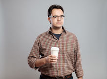 Portrait of man holding a cup of coffee Stock Photos