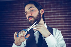 Portrait of man holding cutting beard with scissors Royalty Free Stock Images