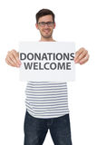 Portrait of a man holding a donation welcome note Royalty Free Stock Photo