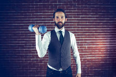 Portrait of man holding dumbbell Stock Images