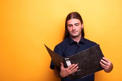 Portrait of man holding a file royalty free stock image