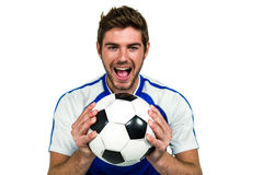Portrait of man holding football with mouth open Royalty Free Stock Images