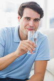 Portrait of a man holding a glass of water Stock Images