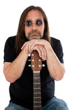 Portrait of man holding a guitar. Portrait of man with sunglasses holding a guitar Royalty Free Stock Image