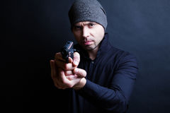 Portrait of a man holding gun Stock Images