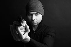 Portrait of a man holding gun Stock Photo