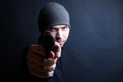 Portrait of a man holding gun Stock Image