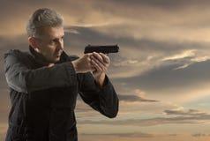 Portrait Of Man Holding Gun Royalty Free Stock Image