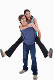 Portrait of man holding his girlfriend on his back Stock Photography